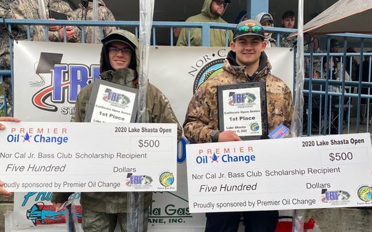 Foothill senior anglers Brad Reagan (right) and Dalton Tatom (left)  with scholarships checks at Lake Shasta on Jan. 12.