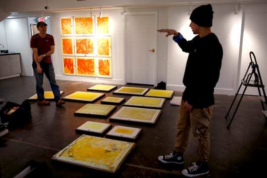 """Former Marines Matthew Boulay, left, and Eddie Caine are pairing up to create """"Yellow Squares Bombed"""", to combine their fine art and graffiti art styles at the Salem Art Association on Jan. 8, 2020. The exhibit runs through Feb. 20."""