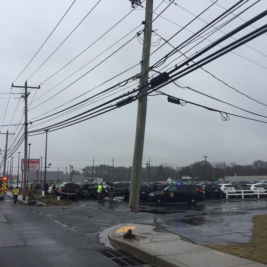 Police and Salisbury Fire Department personnel respond to the crash at Stafford Kia auto dealership in Salisbury on Tuesday, Jan. 14.