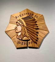 This wooden sign hangs in the front office of the Sheboygan County Sheriff's Department.