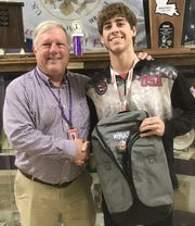 Byrd principal Jerry Badgley poses with Byrd wrestler Jacob Yawn holding his Times/SBSC Athlete of the Week backpack.