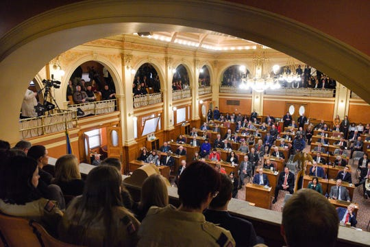 A full room of legislators and and citizens listen as Governor Kristi Noem gives the annual State of the State address on Tuesday, Jan. 14, in the House Chamber at the State Capitol in Pierre.