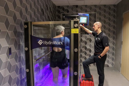 A woman uses the HydroWorx water treadmill at Avera's Human Performance Center, which opened Jan. 6, 2020.