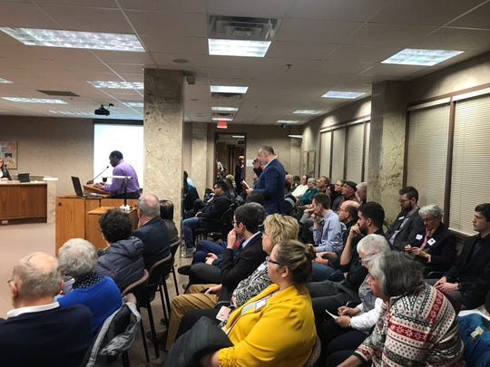 Members of the public fill the room at a Jan. 14 Minnehaha County Commission meeting to give input on a measure to allow refugees to settle in the county.