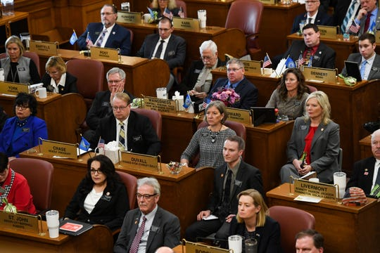 Legislators listen to Governor Kristi Noem give the annual State of the State address on Tuesday, Jan. 14, in the House Chamber at the State Capitol in Pierre.