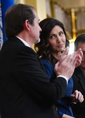 Governor Kristi Noem looks at Speaker of the House Steven Haugaard after thanking him for a comment following her State of the State address on Tuesday, Jan. 14, in the House Chamber at the State Capitol in Pierre.