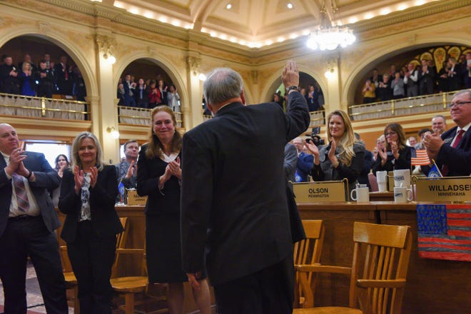 Chief Justice David Gilbertson waves to the room of legislators as he is recognized during Gov. Kristi Noem's State of the State address on Tuesday, Jan. 14, in the House Chamber at the State Capitol in Pierre.