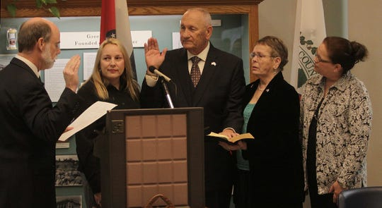 In this photo from 2013, Greene County Clerk Richard Struckhoff, left, swears in Commissioner Harold Bengsch, who is with daughters Meschiel Lankford, left, and Kena Melton, right, and wife, Darlene.