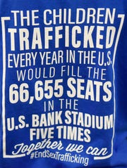 T-shirts are available to purchase to raise money for victims of sex trafficking Tuesday, Jan. 14, 2020, at Kimball High School.