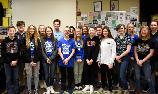 Freshmen at Kimball High School pose for a group photo Tuesday, Jan. 14, 2020. The students started an online store to raise money for victims of sex trafficking.
