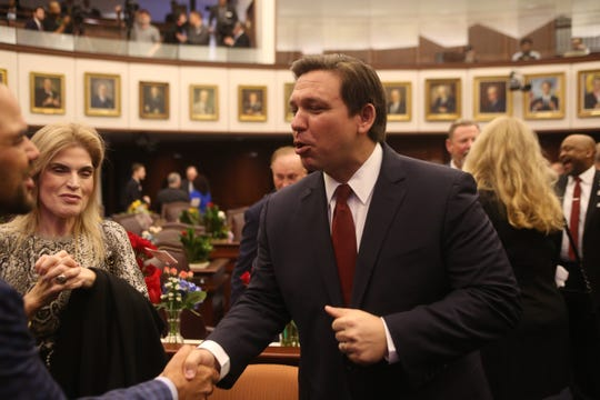 Gov. Ron DeSantis arrives in the Senate chamber before the start of the body's first meeting for the 2020 legislative session Tuesday, Jan. 14, 2020.