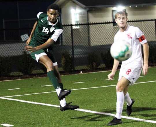 Lincoln junior David Monroe clears a ball as Lincoln's boys soccer team beat Leon 3-2 at Gene Cox Stadium on Jan. 13, 2020.