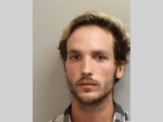 Aaron Lennihan, 23, is in custody after police say he stole a FedEx truck and drove it onto the runway at the Tallahassee International Airport.