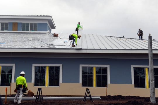 Construction crews cut and install the metal roofing for the south wing of the new Ardie R. Copas State Veterans' Nursing Home on Tuesday, Jan. 14, 2020, in Tradition. The facility will have 120 beds, 60 of which will be reserved for residents with Alzheimer's disease and dementia. The facility sits on 28 acres of land donated by the Tradition Land Company.