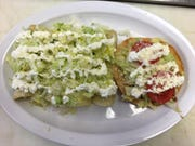 Taquiera Torres' green enchiladas and tostadas