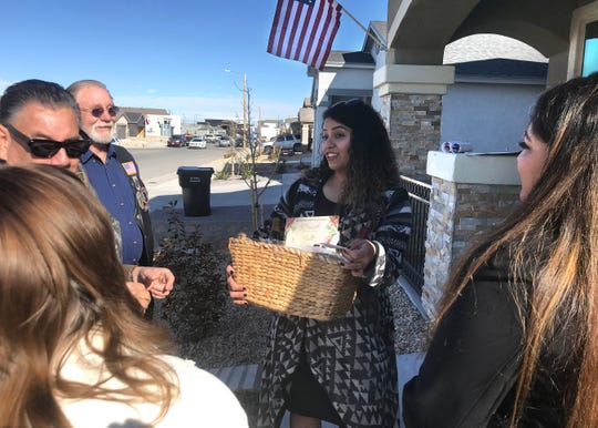 Lorena Mendez, widow of Marine Lance Cpl. Norberto Mendez-Hernandez, stands outside her new home after receiving a welcome basket from Horizon City community members. Mendez said she chose to live in Horizon City because of the friendly community.