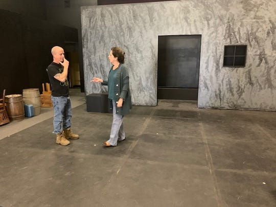 Will Shupe, left, technical director of the new ARTSpace theater venue in Simi Valley, and Jan Glasband, artistic director of the Actors' Repertory Theatre of Simi, discuss logistics on the stage of the new theater, which opens Saturday night.