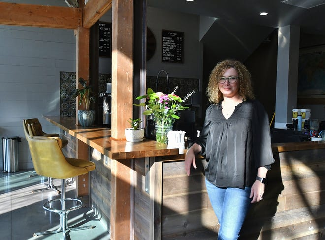Exeter Coffee Co. owner Staci Welch poses inside her spacious new E Street location.
