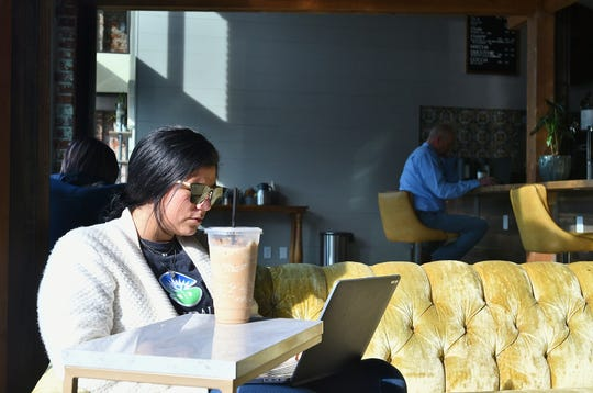 Sierra Myers of Strathmore enjoys a frappuccino at Exeter Coffee Co.'s new location on Jan. 10.