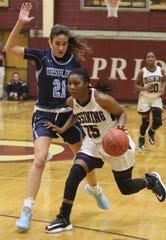 Ursuline's Sonia Citron (21) guards Ossining's Adriana McFadden (15) during girls basketball game at Ossining High School Jan. 13, 2020. Ossining looses to Ursuline 54-72.