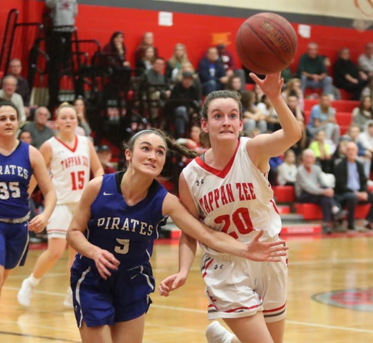 Tappan Zee's Kaleigh Beirne (20) and Pearl River's Mary Windram (5) work for a loose ball during girls basketball action at Tappan Zee High School in Orangeburg on Tuesday, January 14, 2020.