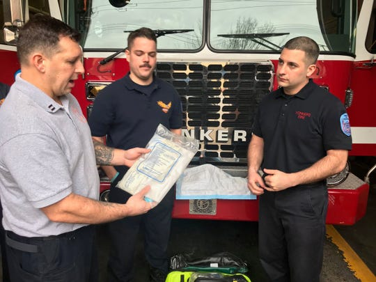 Yonkers fire officials helped deliver a baby girl Tuesday morning. The delivery was the first tour for probationary firefigher Michael Iacovello, right. From left are Captain Chris Canfield, firefighter Tommy Kilduff and Iacovello.