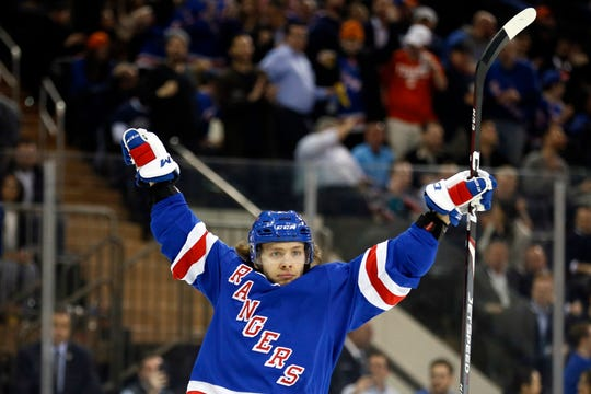 Jan 13, 2020; New York, New York, USA; New York Rangers left wing Artemi Panarin (10) celebrates getting an assist on a goal scored by Rangers left wing Chris Kreider (not pictured) during the second period against the New York Islanders at Madison Square Garden. Mandatory Credit:  Adam Hunger-USA TODAY Sports