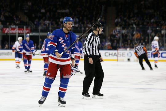 Jan 13, 2020; New York, New York, USA; New York Rangers defenseman Brendan Smith (42) leaves the ice after receiving a game misconduct penalty against the New York Islanders during the first period at Madison Square Garden. Mandatory Credit:  Adam Hunger-USA TODAY Sports