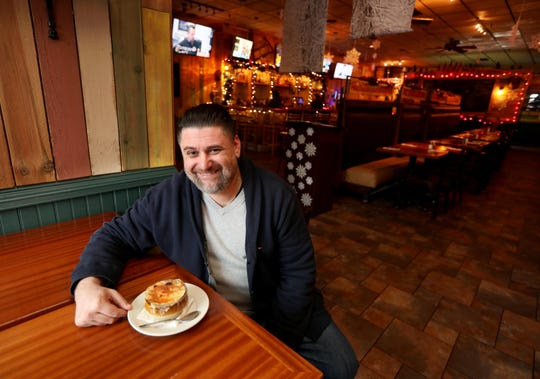 Charles Amchir, owner of Saw Mill Tavern in Ardsley, photographed with a vegetarian french onion soup Ardsley Jan. 14, 2020. Amchir's restaurant will be featured on a new Food Network Show.