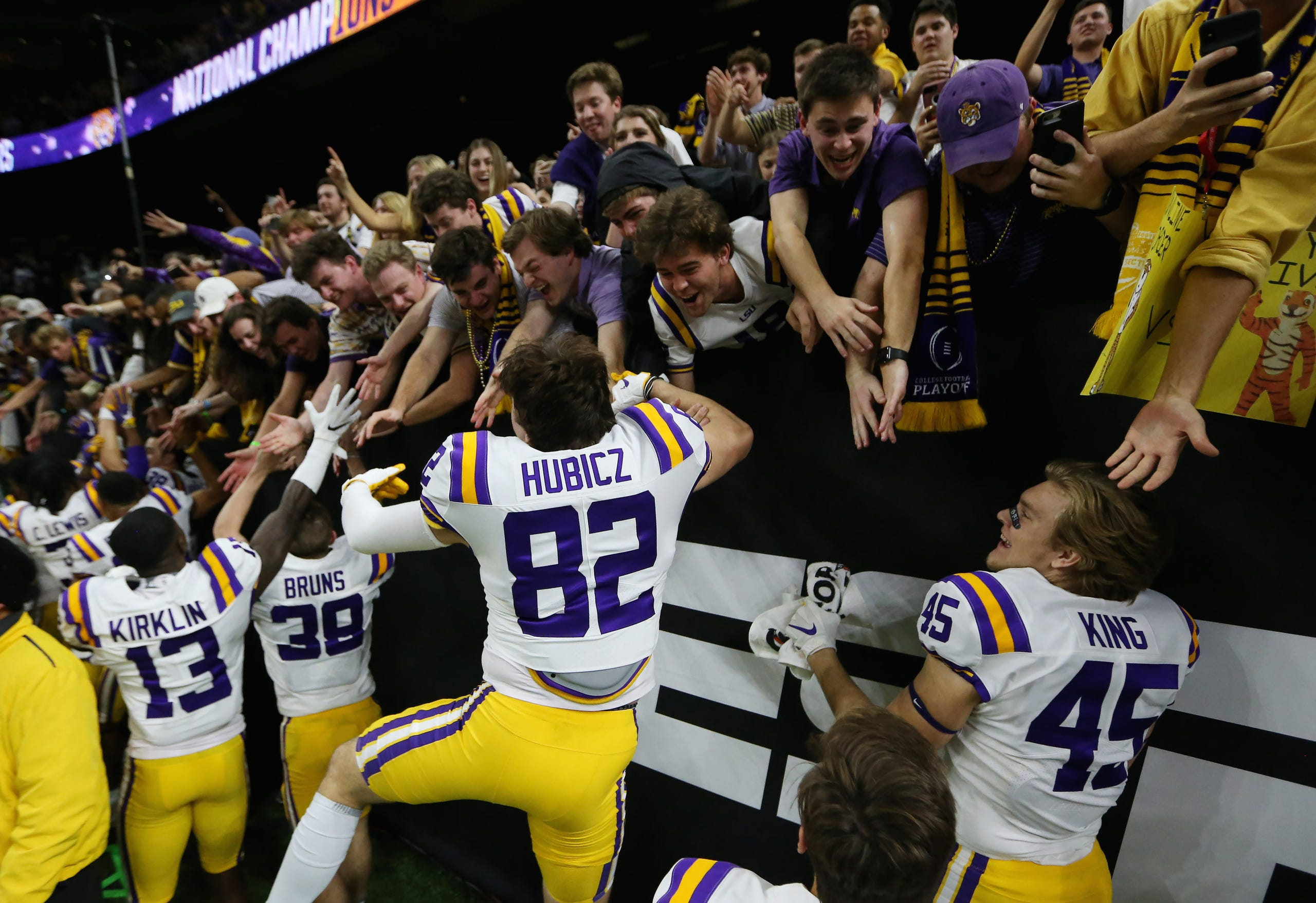 The LSU Tigers celebrate with the student section after their win over Clemson.
