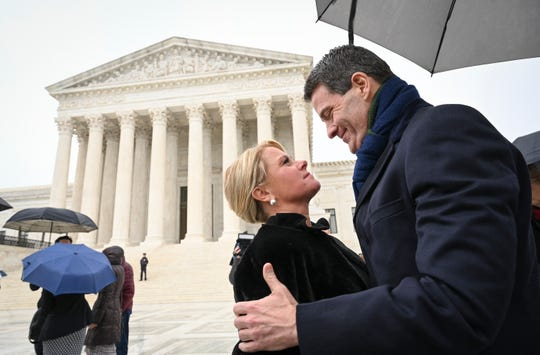 Bridget Kelly, former deputy chief of staff for then-New Jersey Gov. Chris Christie, and Bill Baroni, his top appointee at the Port Authority of New York and New Jersey, embrace outside the Supreme Court after oral argument Tuesday.