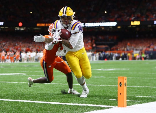 LSU tight end Thaddeus Moss fights off Clemson cornerback Derion Kendrick for a touchdown in the third quarter in the College Football Playoff national championship game at Mercedes-Benz Superdome.