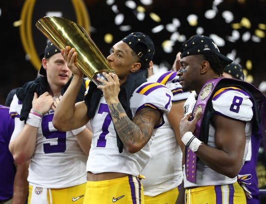 LSU safety Grant Delpit kisses the national championship trophy after the Tigers defeated Clemson in the College Football Playoff national championship game at Mercedes-Benz Superdome.