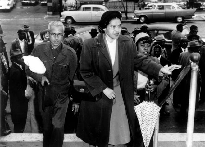 Rosa Parks arrives at circuit court to be arraigned in the racial bus boycott, Feb. 24, 1956 in Montgomery, Alabama. The boycott started Dec. 5, 1955 when Parks was fined for refusing to move to the black section of a city bus.
