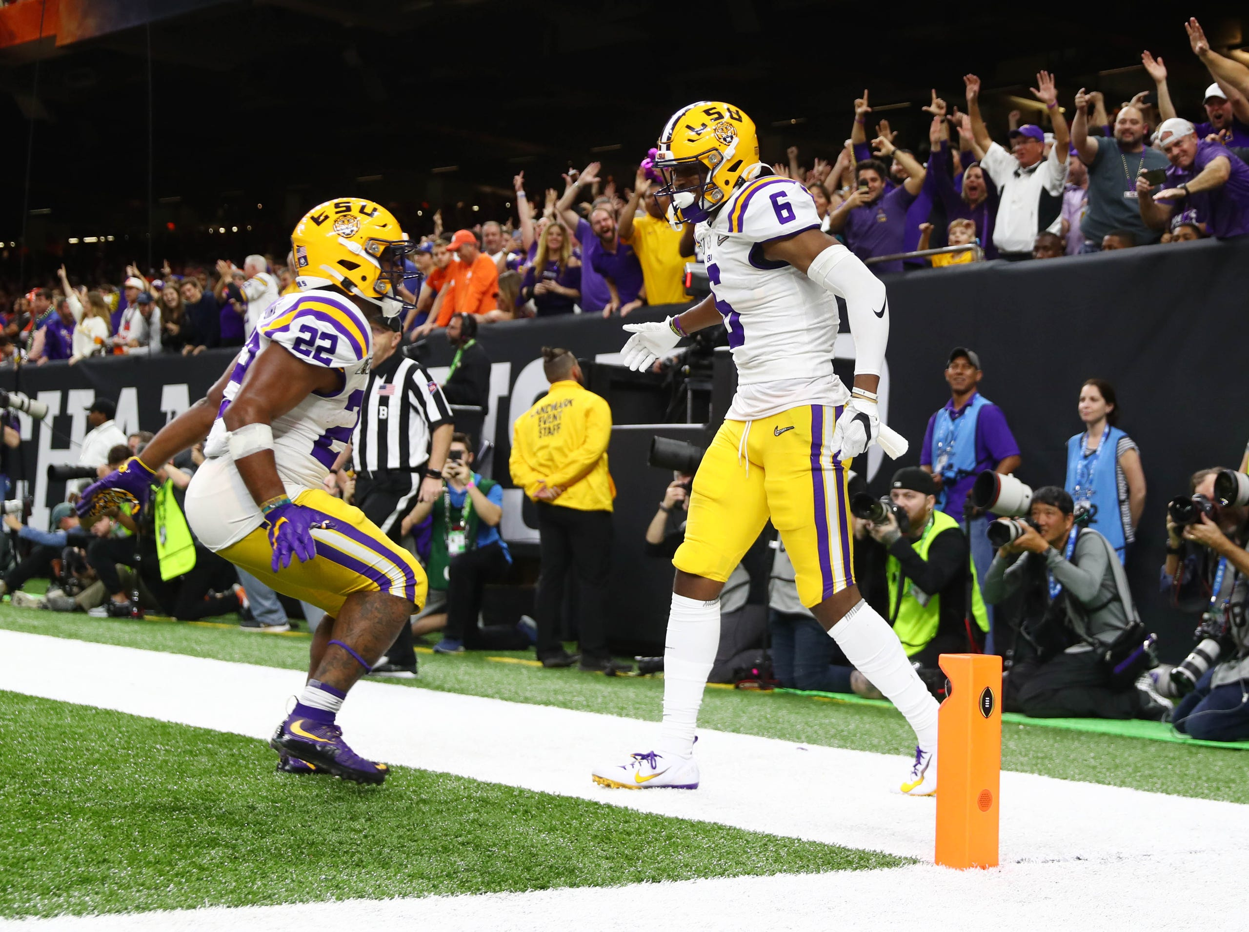 LSU Tigers wide receiver Terrace Marshall Jr. (6) celebrates with running back Clyde Edwards-Helaire after scoring a touchdown in the fourth quarter.