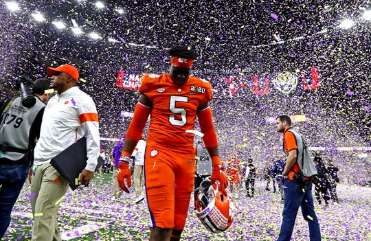 Clemson defensive end K.J. Henry walks off the field after the Tigers lost to LSU in the College Football Playoff national championship game at Mercedes-Benz Superdome.