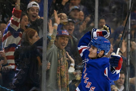 New York Rangers defenseman Adam Fox celebrates after scoring a goal against the New York Islanders during the second period at Madison Square Garden.