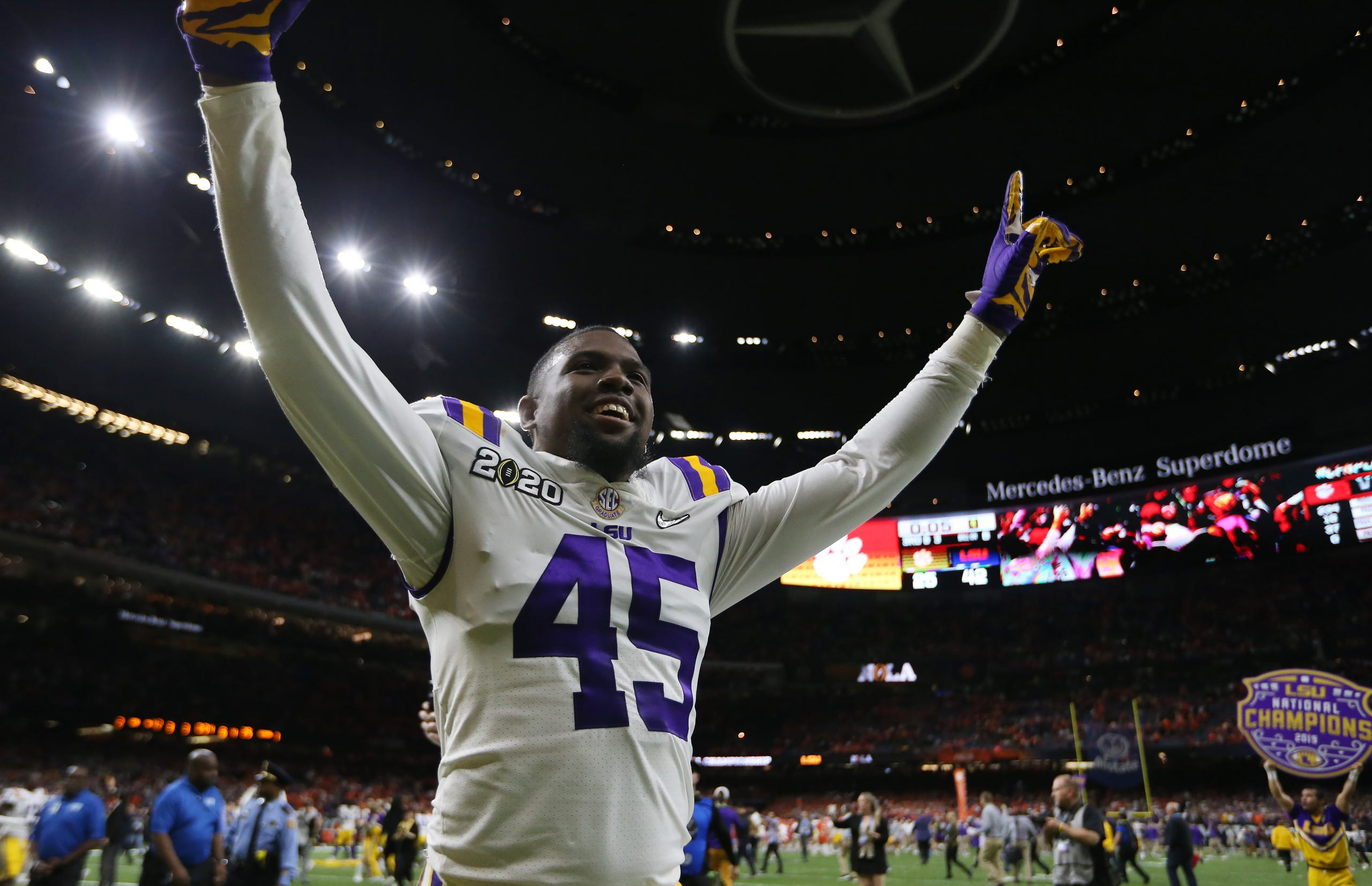 LSU Tigers linebacker Michael Divinity Jr. celebrates after defeating the Clemson Tigers.