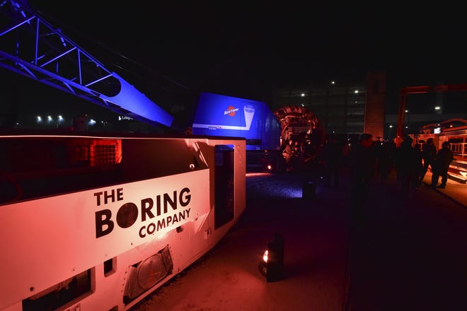 Electric locomotives and tunnel boring equipment are displayed before an unveiling event for The Boring Company Hawthorne test tunnel December 18, 2018 in Hawthorne, California.