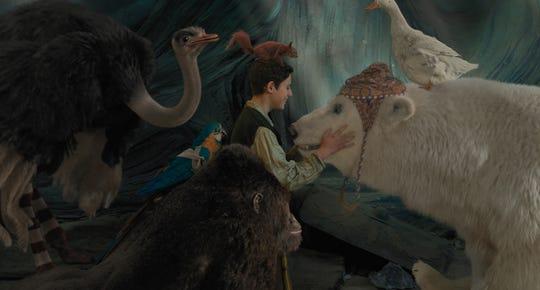 "Tommy Stubbins (Harry Collett) makes friends with ostrich Plimpton (voiced by Kumail Nanjiani), squirrel Kevin (Craig Robinson), polar bear Yoshi (John Cena), duck Dab-Dab (Octavia Spencer), gorilla Chee-Chee (Rami Malek) and parrot Polynesia (Emma Thompson) in ""Dolittle."""