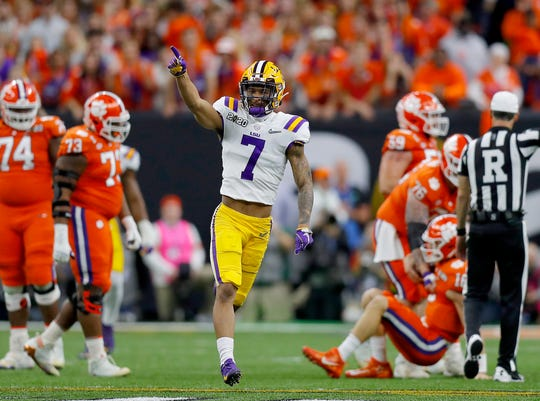 LSU defensive back Grant Delpit reacts after sacking Clemson quarterback Trevor Lawrence during the first quarter of the College Football Playoff national championship game at Mercedes-Benz Superdome.