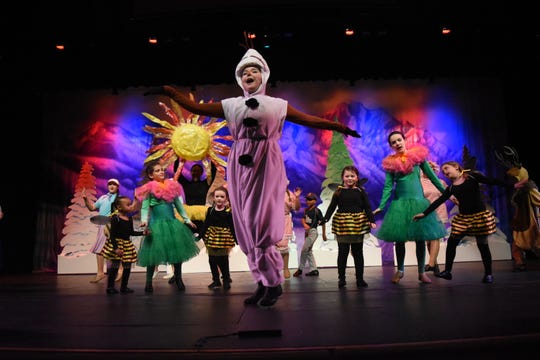"Belle Fine (front) portrays Olaf in LBM Productions' presentation of Disney's ""Frozen Jr."""
