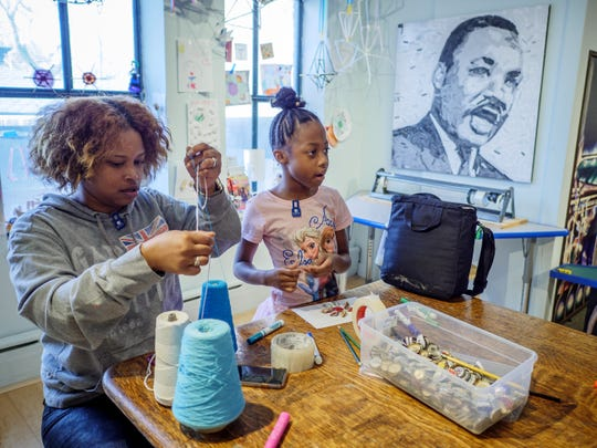Young people engage in crafts and other activities in celebration of Dr. Martin Luther King Jr. Day at the Newark Museum of Art.