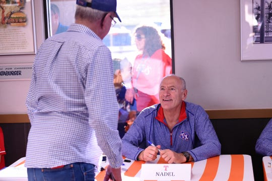 Radio broadcaster Eric Nadel talks with a fan during the Texas Rangers Winter Caravan stop at the Whataburger on Danville in Abilene on Tuesday, Jan. 14, 2020.