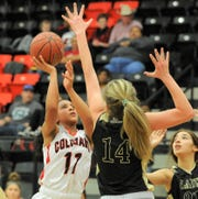 Colorado City guard Mia Monroe (11) tries to get a shot over Clyde post Liz Underwood in a District 5-3A game Tuesday at Colorado High School.