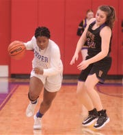 Cooper's Dazz Larkins, left, brings the ball up court as Wylie's Ceci Widder defends during the second half. The Lady Coogs won the District 4-5A game 69-40 on Tuesday, Jan. 14, 2020, at Cougar Gym.
