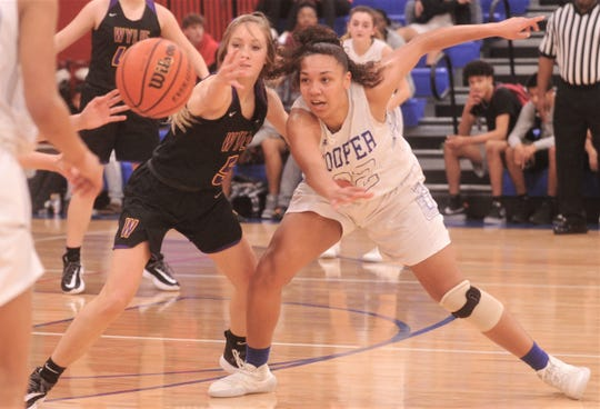 Cooper's Jennika Willis, right, and Wylie's Morgan Travis battle for a loose in the second half. The Lady Coogs beat Wylie 69-40 in the District 4-5A game Tuesday, Jan. 14, 2020, at Cougar Gym.