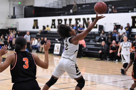 Abilene High's Syncere Reed (2) lays the ball in for a basket against Haltom City Haltom at Eagle Gym on Tuesday. Reed finished with seven points before fouling out in the 48-44 win.