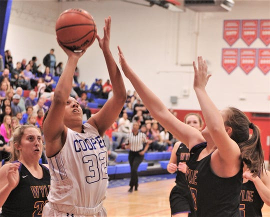 Cooper's Jennika Willis (32) shoots over a Wylie defender in the first quarter. The Lady Coogs beat Wylie 69-40 in the District 4-5A game Tuesday, Jan. 14, 2020, at Cougar Gym.