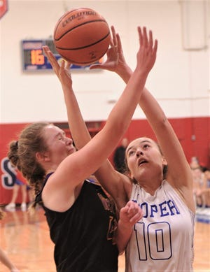 Cooper's Brianna Garcia, right, battles Wylie's Leah Gomez for a rebound in the first half. Cooper beat the Lady Bulldogs 69-40 in the District 4-5A game Tuesday at Cougar Gym.